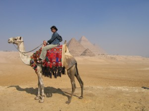 on a camel in front of the pyrmids